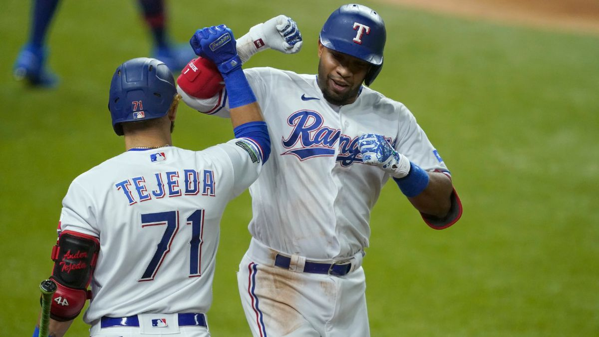 Texas Rangers' Anderson Tejeda (71) and Elvis Andrus, right, celebrate after Adrus hit a solo home run off of Los Angeles Angels' Andrew Heaney in the second inning of a baseball game in Arlington, Texas, Tuesday, Sept. 8, 2020.