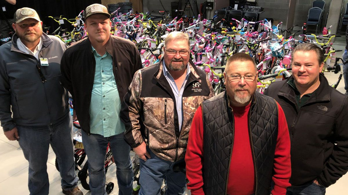 Members of the Heart of Texas Builders Association rolled 95 bicycles into the KWTX studio, many of which the group purchased and members assembled. (Staff photo)