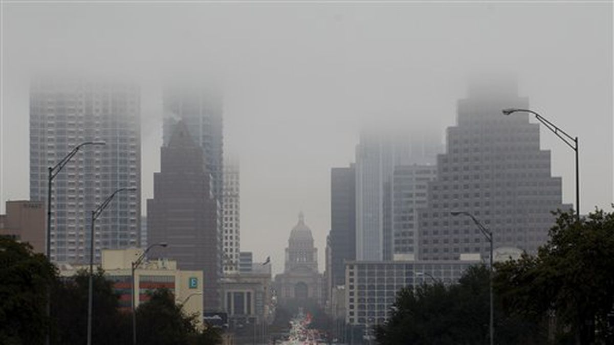 The Texas Capitol and downtown buildings fade into the fog, Tuesday, Jan. 24, 2012, in Austin, Texas. (AP Photo/Eric Gay)