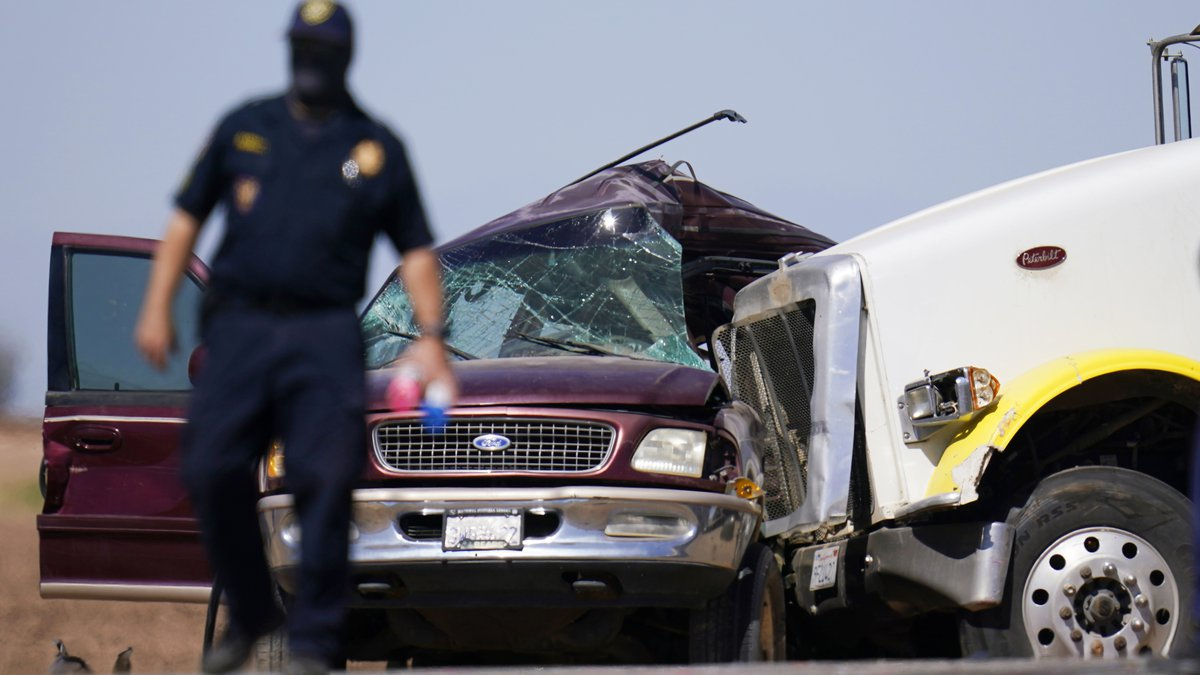 Law enforcement officers work at the scene of a deadly crash in Holtville, Calif., on Tuesday,...
