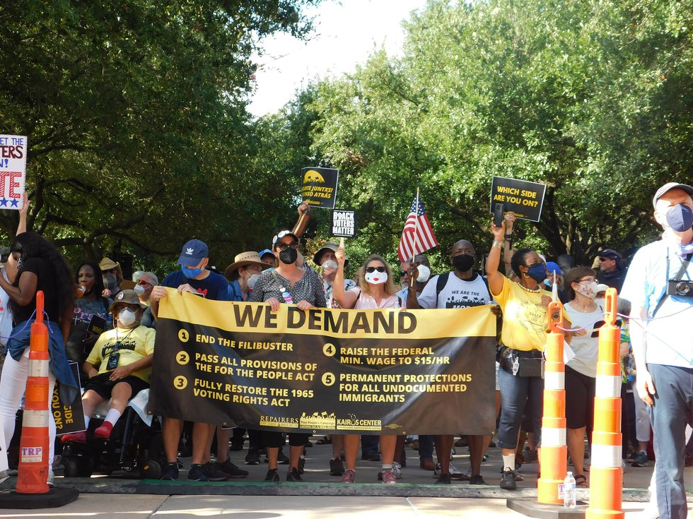 Protesters march for voting rights at the Texas Capitol in Austin, Texas on Saturday, July 31,...