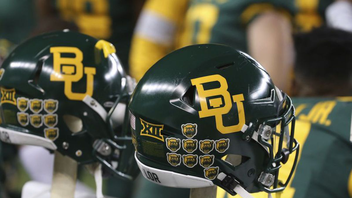 Baylor helmets on the bench in an NCAA college football game against West Virginia in Waco,...