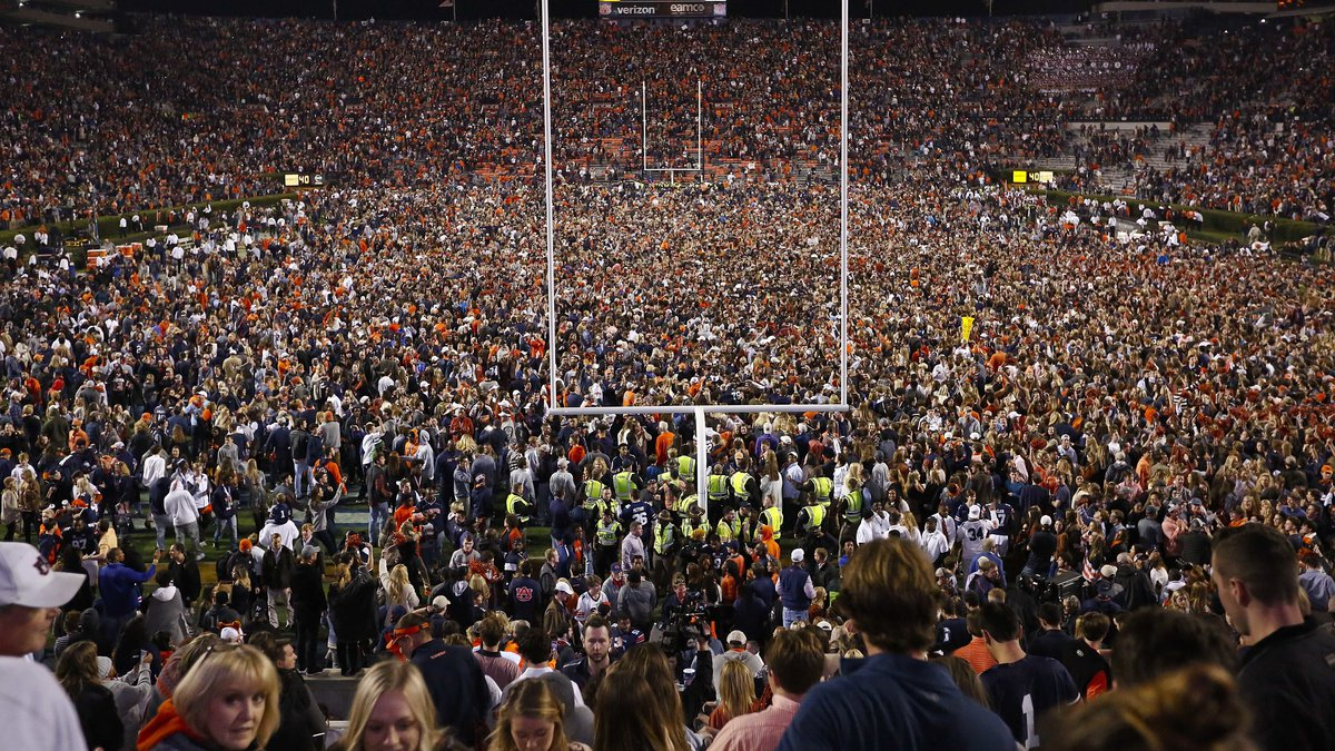 FILE - Fans rush the field after Auburn defeated Alabama in the Iron Bowl NCAA college football...