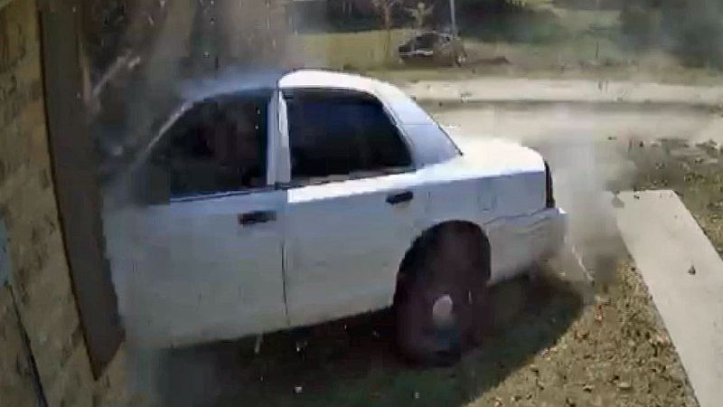A security camera captured the moment when a car whose brakes evidently failed smashed into a...
