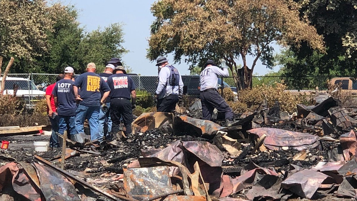 State and federal investigators were sifting through the rubble of the historic church for a...