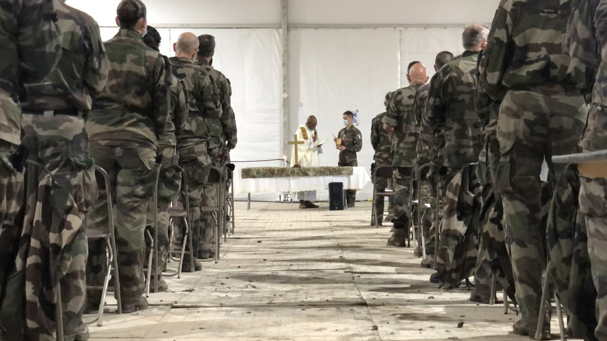 French and American soldiers took a much-needed break from training to hold an Easter Mass...