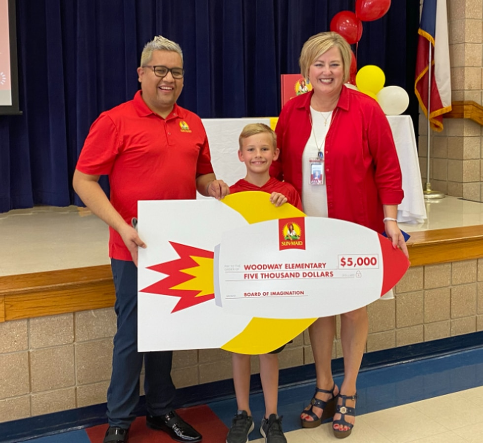 Sun-Maid presented a $5,000 check to Woodway Elementary School.