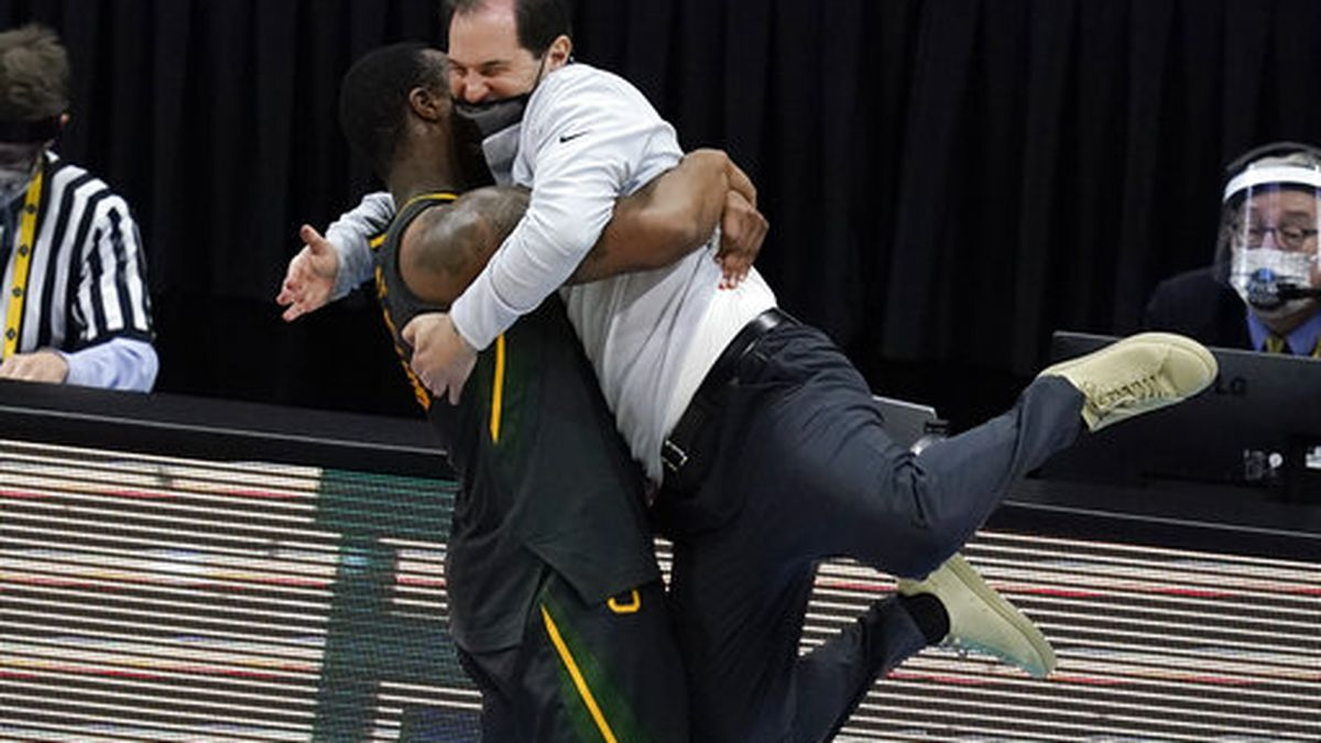 Baylor head coach Scott Drew gets a hug from guard Mark Vital at the end of the championship...