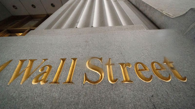 FILE - In this Nov. 5, 2020 file photo, a sign for Wall Street is carved in the side of a...