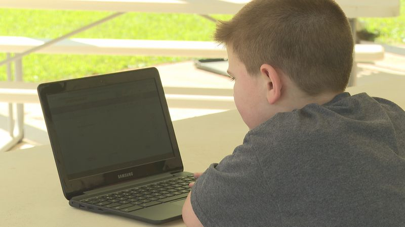 Harlan County student completes his work virtually.