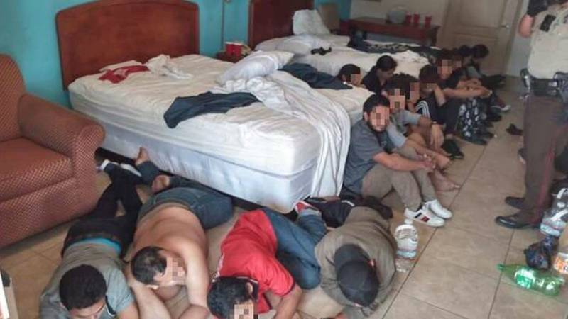 Sept. 20, 2021 – Migrants in crowded hotel room.