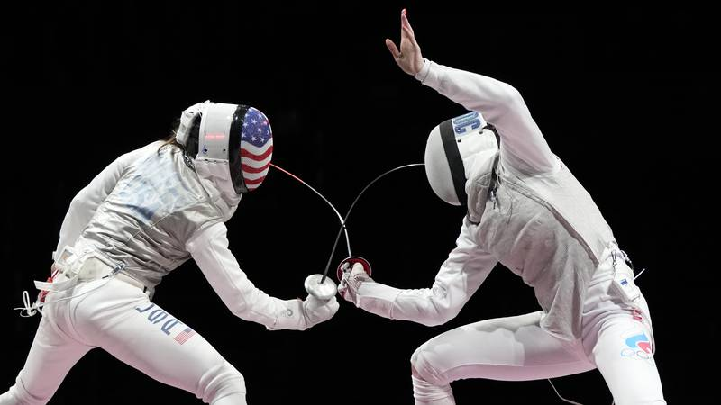 Inna Deriglazova of the Russian Olympic Committee, right, and Lee Kiefer of the United States...