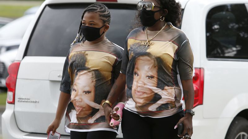 Mourners are seen wearing shirts with Ma'Khia Bryant's picture as they arrive for the funeral...