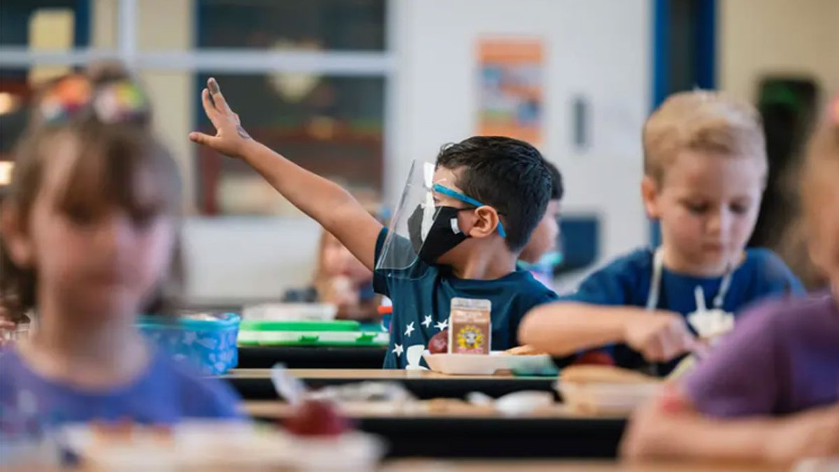 File Photo: A student wearing a mask and face shield eats lunch at Blanco Vista Elementary...