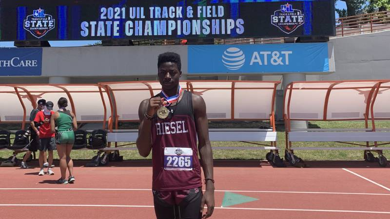 Jamariyan Howlett shows off his gold medal at the state track and field meet