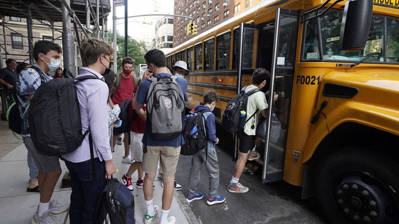 FILE — In this Sept. 13, 2021, file photo, students board a school bus on New York's Upper West...