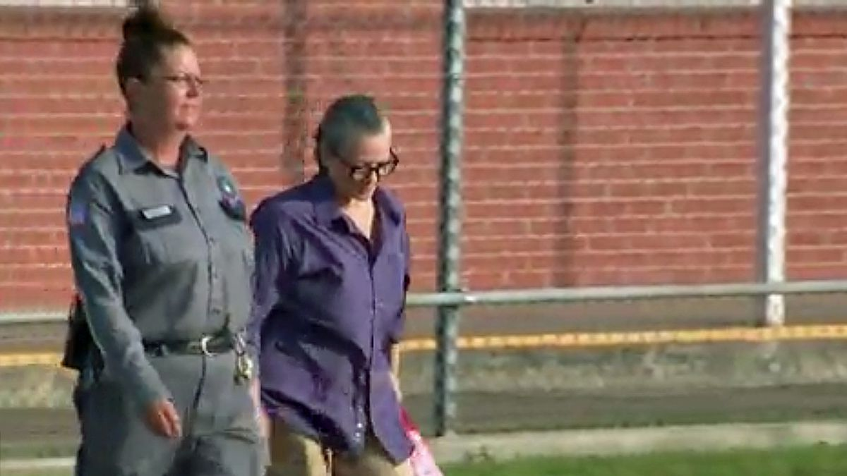 Clara Harris was escorted by a corrections officer as she left a state prison unit in...
