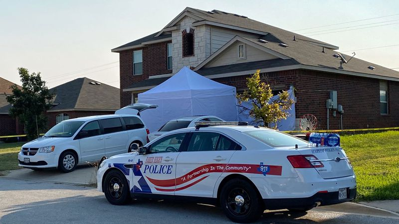 Crime scene tape surrounded the house Thursday morning and a white tent has been erected...