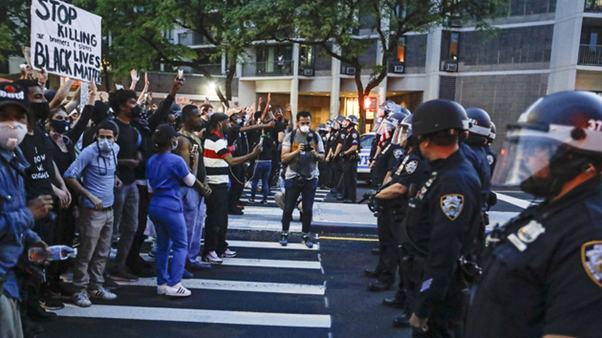 Protesters confront New York Police officers as part of a solidarity rally calling for justice over the death of George Floyd, Wednesday, June 3, 2020, in the Brooklyn borough of New York. Floyd died after being restrained by Minneapolis police officers on Memorial Day. (AP Photo/Frank Franklin II)
