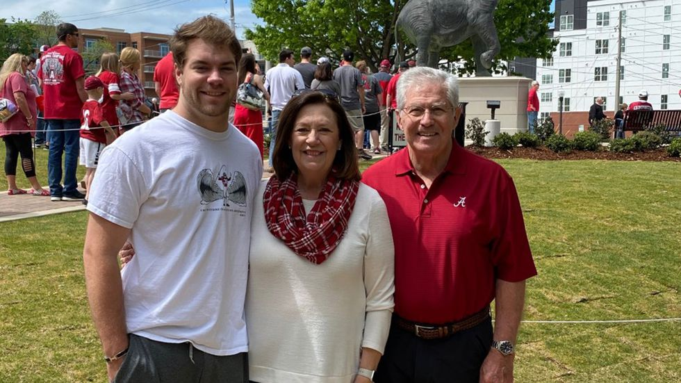 Matthew Barnhill with his grandparents, Roberta and Mike Robinson.