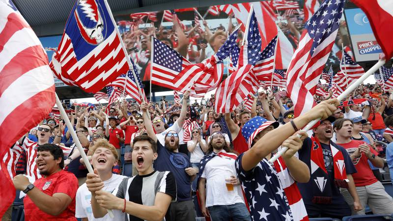 United States soccer fans react before a CONCACAF Gold Cup soccer match against Canada in...