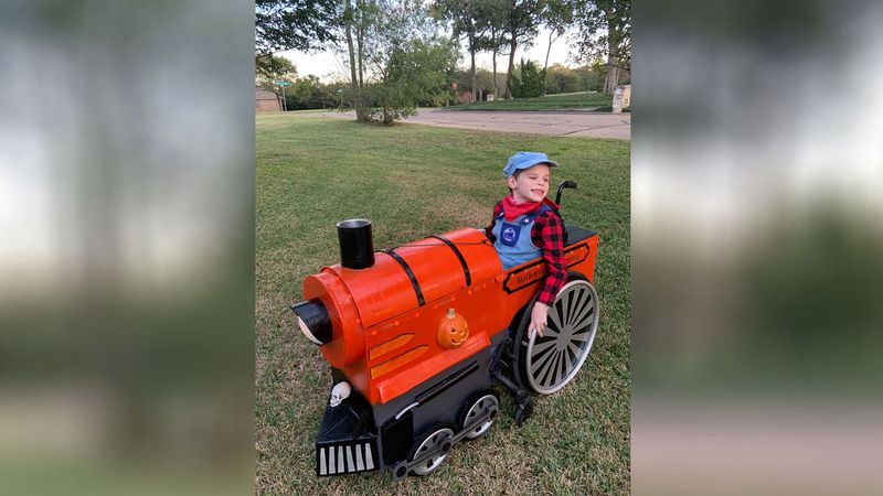 Family members, for another year, transformed Colin Ely's wheelchair into a costume on wheels...