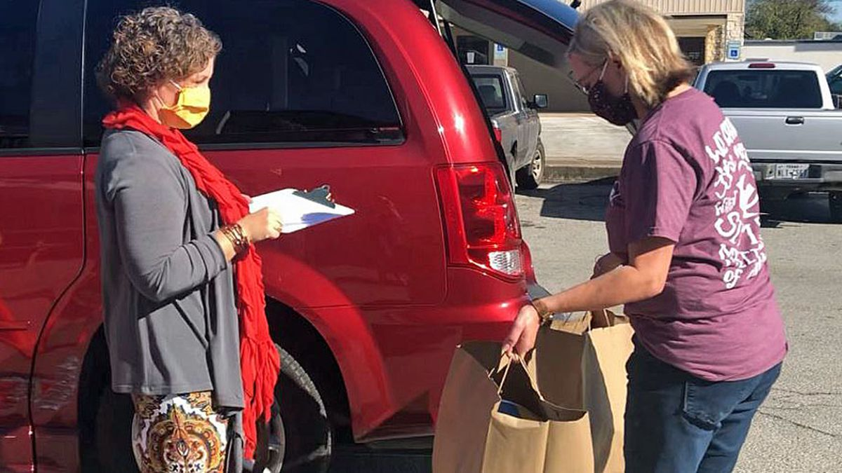 Local businesswoman teamed up with local businesses Wednesday to provide Thanksgiving meals to...