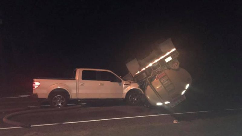 A rollover leading to an oil spill shut down all five lanes of a local highway early Thursday...