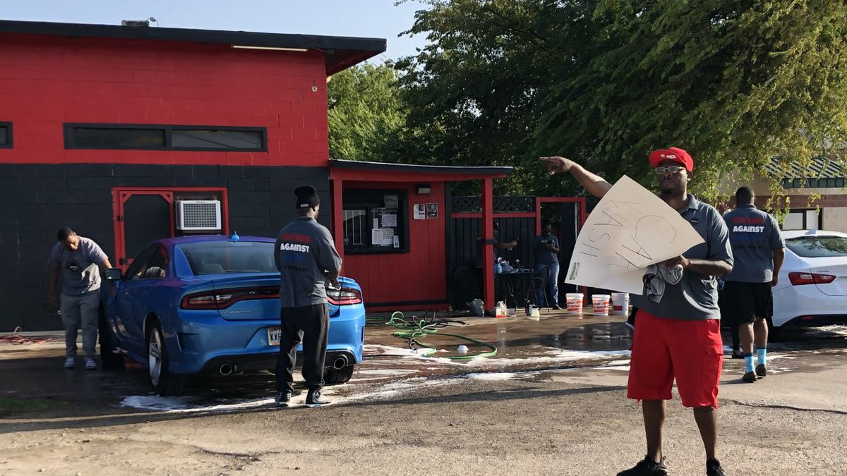 A local organization hosted a car wash fundraiser Sunday for the family of Jervontrae Robinson, who was shot at his home on September 14.