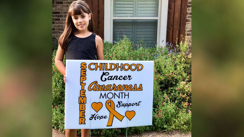 McKenzie Covert, 8, set up shop in the  front yard of her, home, offering the cold treats for...