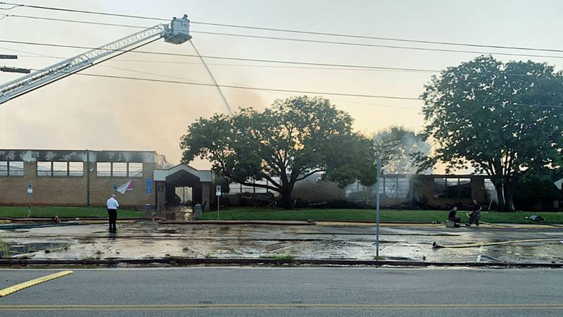 Crews remained on the scene Tuesday, dousing hotspots and assessing the damage.