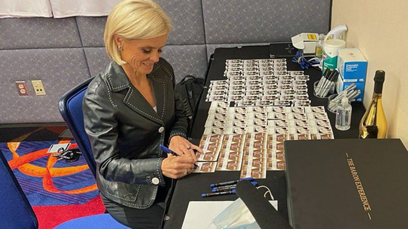 Kim Mulkey signed dozens of basketballs and playing cards Thursday for the Naismith Hall of...