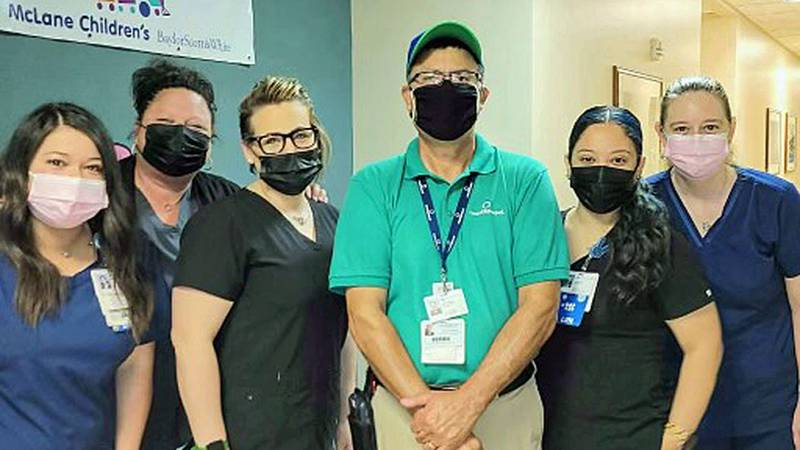 Tony Granillo (center) and the clinic staffers whose silent visits are now filled with...