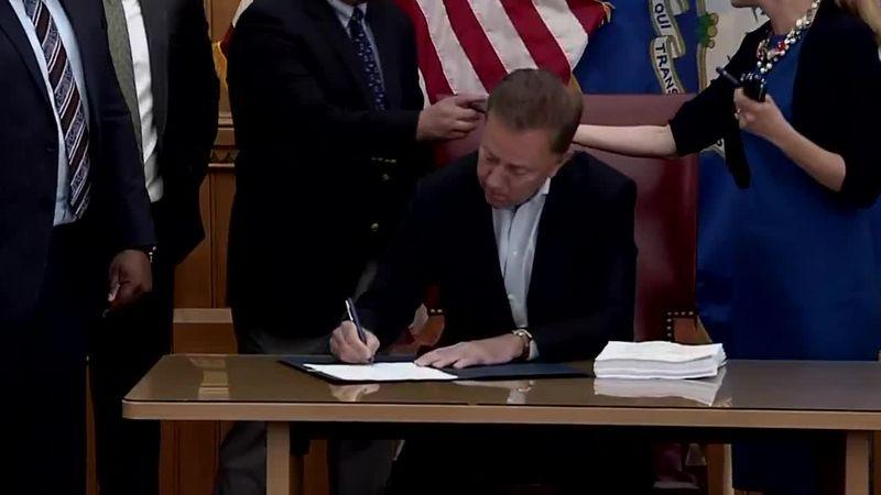 Connecticut Gov. Ned Lamont signs a bill legalizing recreational marijuana.