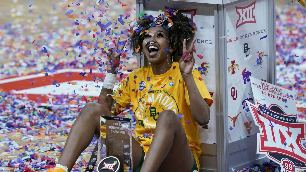 Baylor's DiDi Richards celebrates after winning an NCAA college basketball game against West...