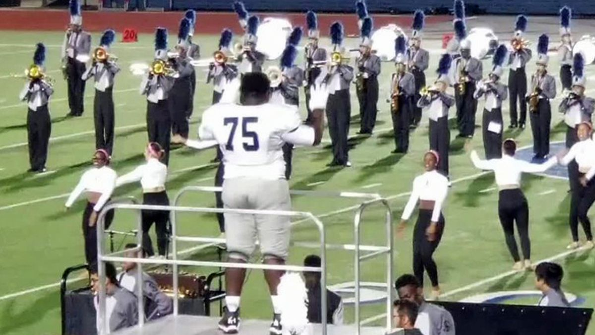 Freddy Hicks directs the band at halftime. (Courtesy photo)