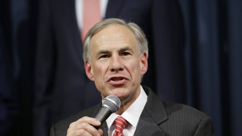 Texas Attorney General Greg Abbott speaks during a news conference with Gov. Rick Perry in the...