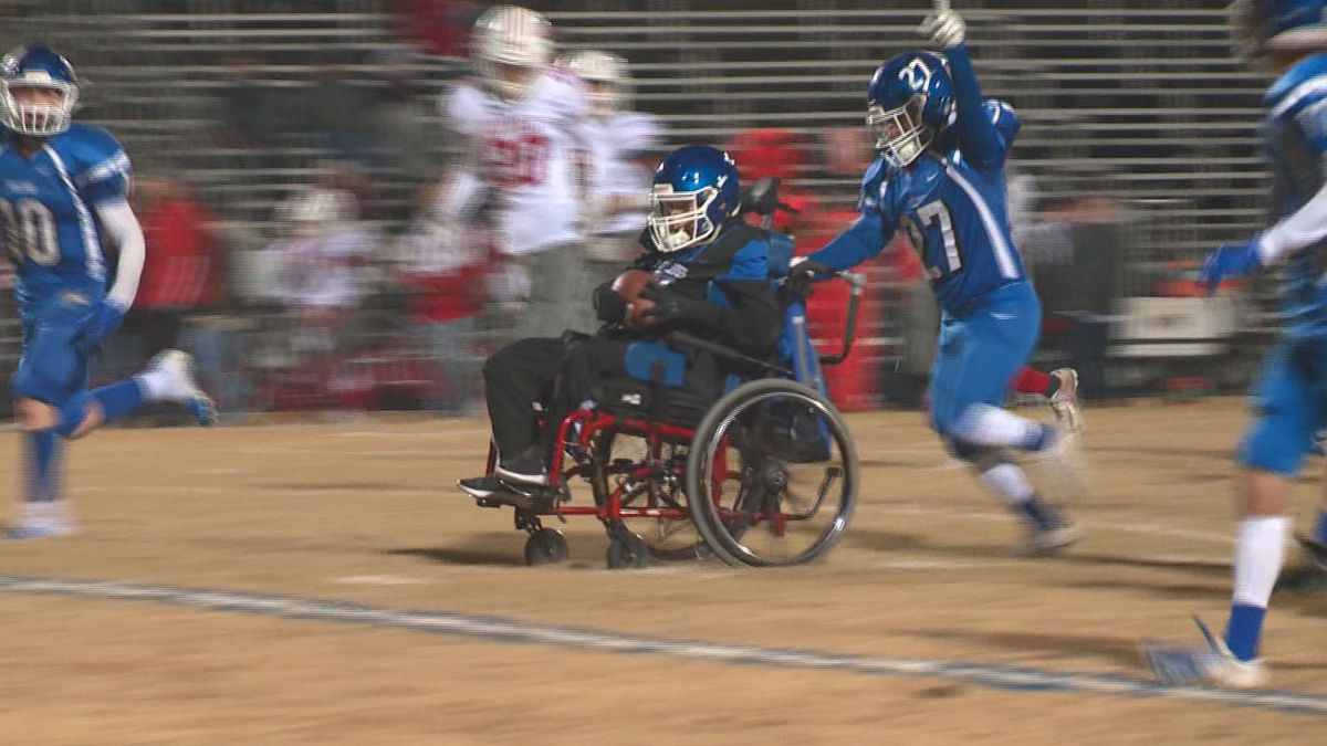 Sophomore Conner Castillo is pushed in a wheelchair by his brother Aaron, a senior, to score a touchdown for for the Bosqueville Bulldogs. (Photo by Jon Black)