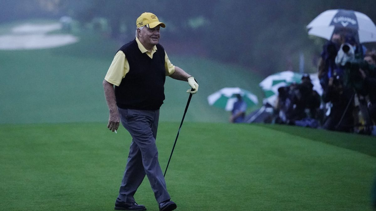 Jack Nicklaus walks off the tee after hitting a ceremonial first ball before the first round of...