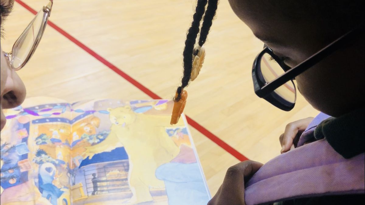 A volunteer helps check the reading level of a Marlin Elementary School student at the district's first Literacy Night.  (Photo by Rissa Shaw)
