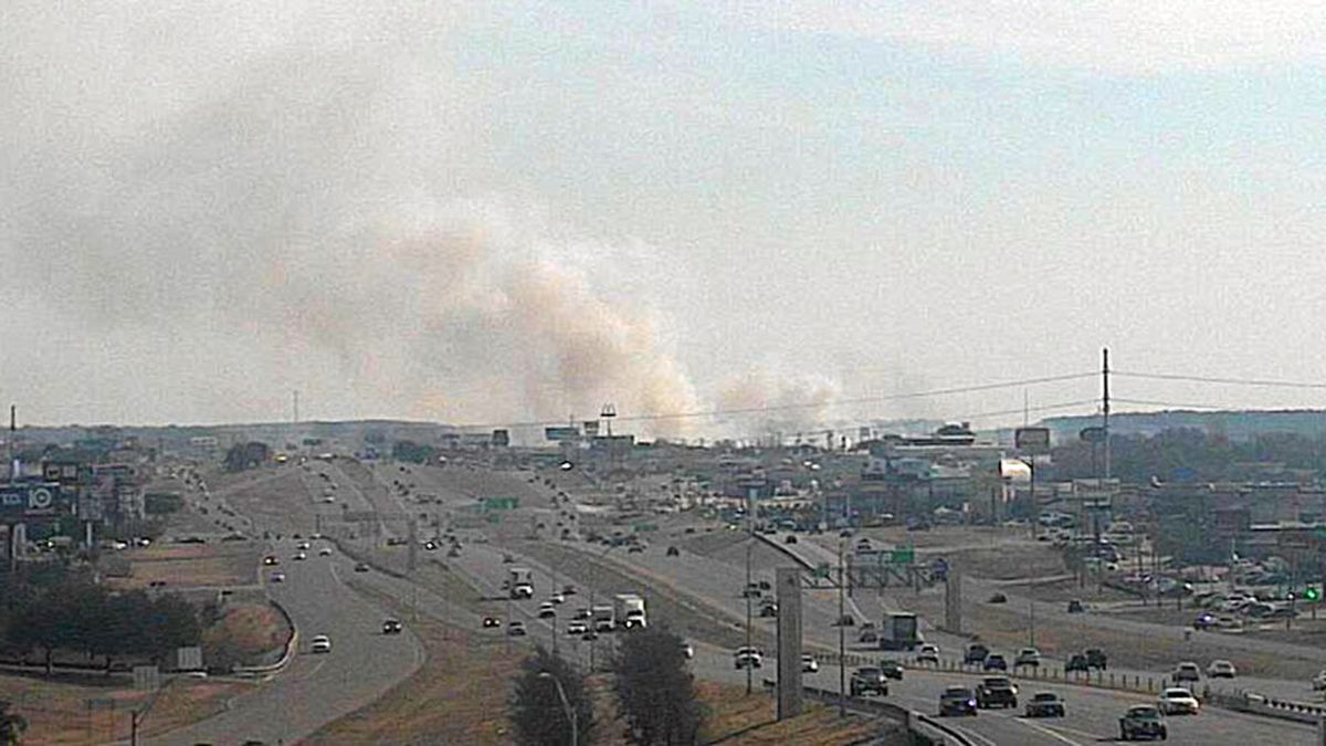 Firefighters were battling a large grassfire Thursday that spread to a shed along Rosewood...
