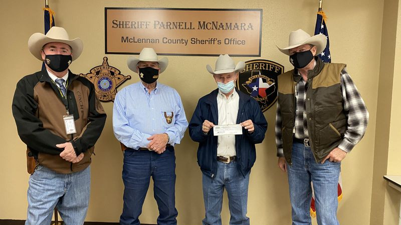 Galen Huddleston with Waco Bargain Center (right center) stopped by MCSO headquarters to drop...