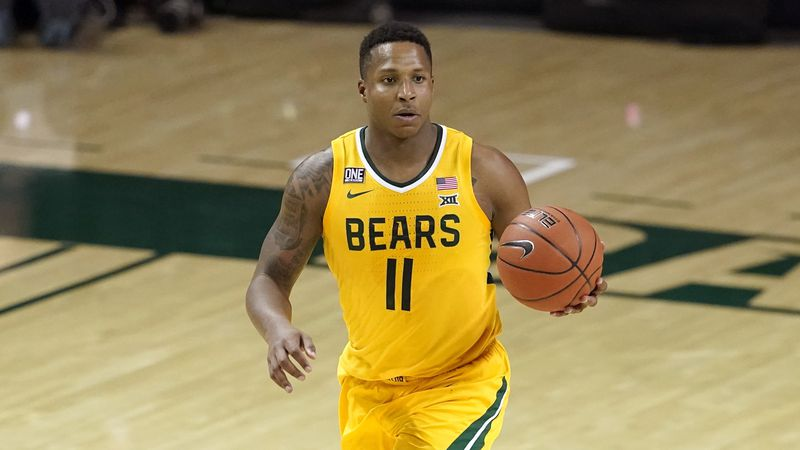 Baylor guard Mark Vital (11) handles the ball during an NCAA college basketball game against...