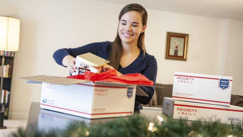 Customer using a print-at-home Click and Ship labels to send holiday packages