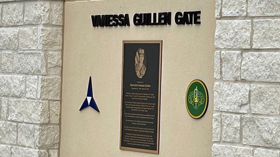 A plaque commemorating Spc. Vanessa Guillen is mounted on the gate.