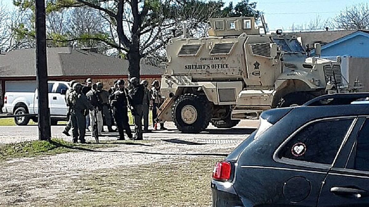 A standoff Sunday in a local residential neighborhood that started with a report of a person in mental distress drew a massive law enforcement response, but ended with only minor injuries. (Courtesy photo)