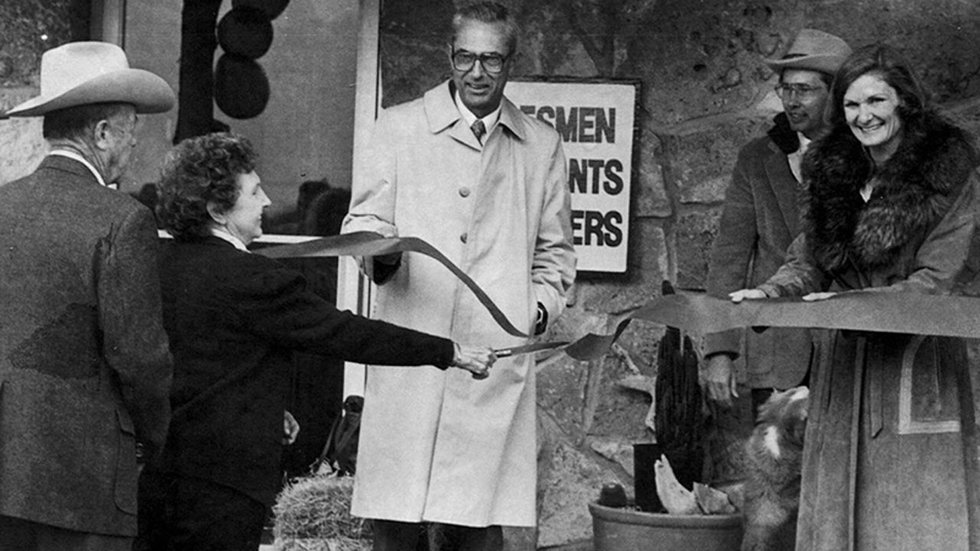 Founders Margaret and Jack Johnson at a ribbon cutting for the company.