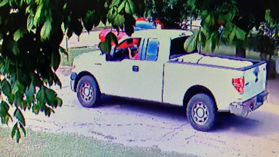 A security camera image of the pickup.