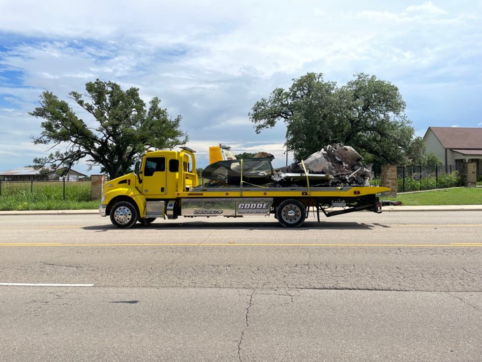 Crews removed the wreckage of the deadly plane crash from the field on Monday.