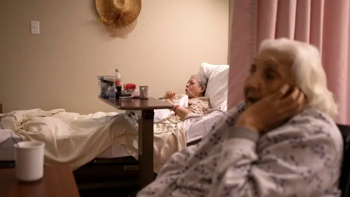 Rosa Ramos and Rebecca Pargas watch television while drinking coffee at the Amistad Nursing and...